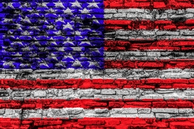 American flag on cracked brick wall